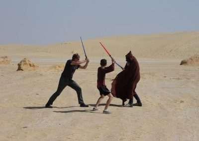 Jeff & sons in lightsaber battle