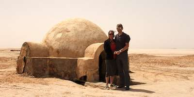 Jeff & Wife in front of igloo house