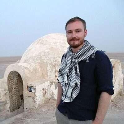 Stephen in front of igloo house in Chott el Jerid